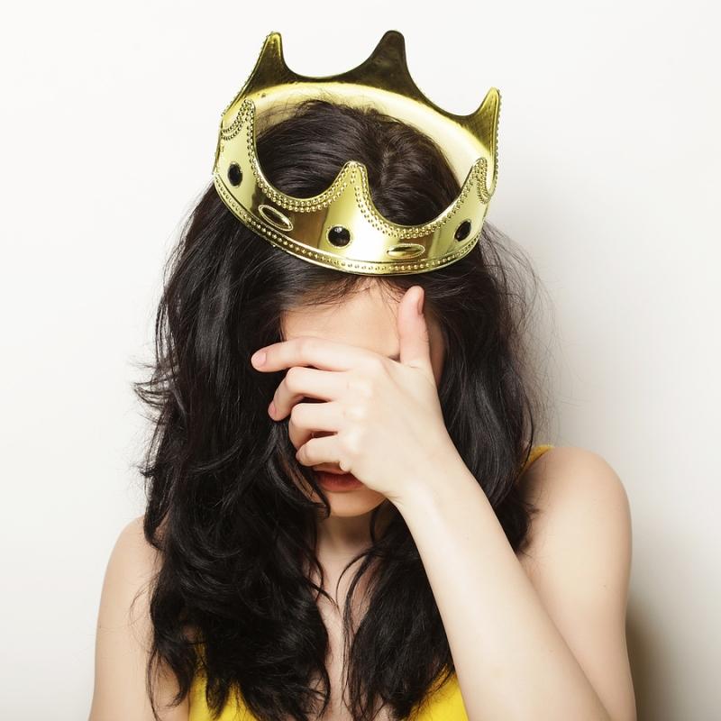 pretty brunette woman wearing crown