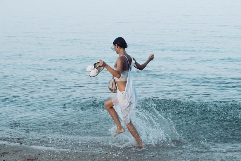 Young Beautiful Lady Run On Sea Or Ocean Beach In Water Splash.